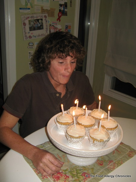 Michael blowing out his candles on his birthday Dairy, Egg and Peanut/Tree Nut Free Vanilla Cupcakes