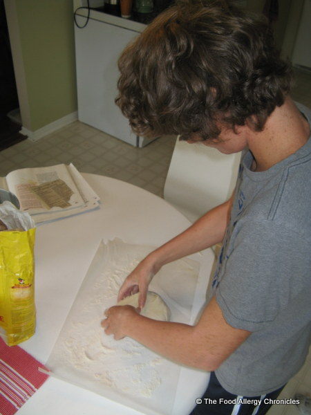 Michael rolling out the Dairy and Peanut/Tree Nut Free pizza dough