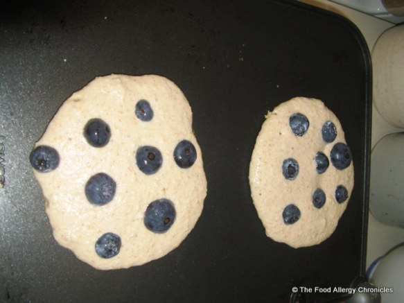 oat flour pancakes with blueberries on top cooking