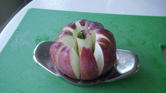cortland apple sliced with apple corer for homemade applesauce