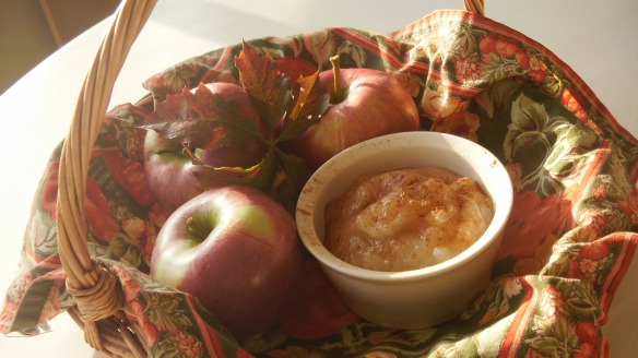 a basket with cortland apples and homemade applesauce