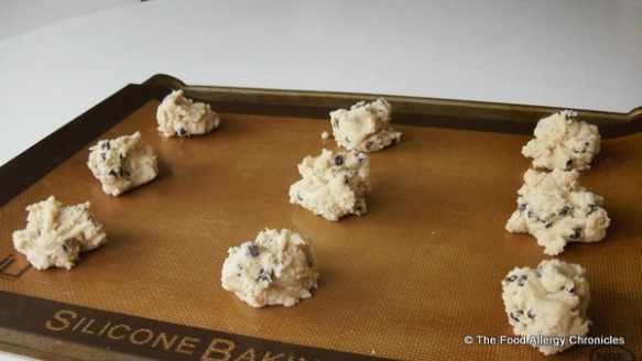 Baking sheet with cookie dough ready for oven