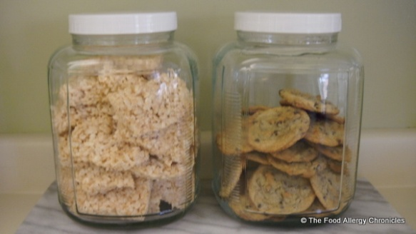 A jar of Dairy and Peanut/Tree Nut Free Rice Krispie Squares and a jar of Dairy, Egg and Peanut/Tree Nut Free Chocolate Chip Cookies