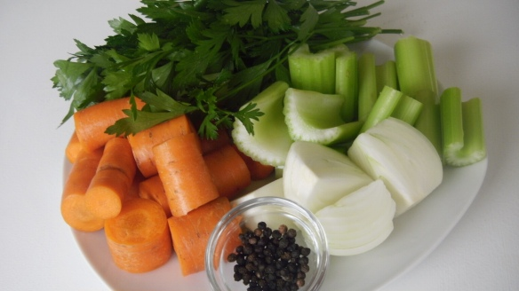 parsely, whole black peppercorns, chopped carrots and celery for homemade chicken broth