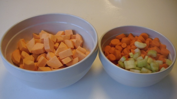 chopped carrots, sweet potatoe and celery, garlic clove to add to finished homemade chicken broth