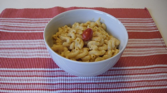 bowl of macaroni and daiya cheddar sauce