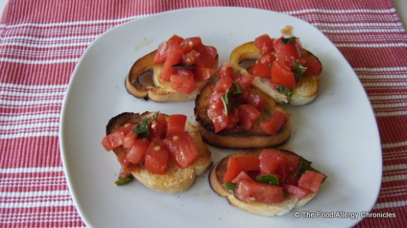 Toasted bread with extra virgiin olive oil, topped with Fresh Tomato Bruschetta