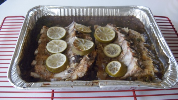 Andy's cooked pork back ribs with Rub Bone Dust, limes and beer