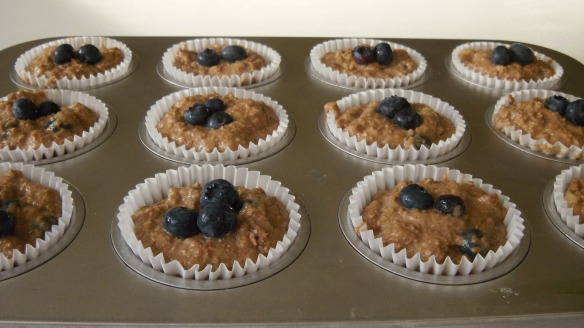 dairy and egg free banana blueberry bran muffin batter in muffin cups