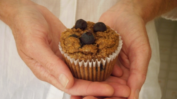 dairy and egg free banana blueberry muffin in hands