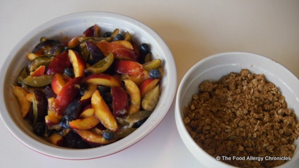 Fruit filling and dairy and peanut/tree nut free crumble in separate bowls