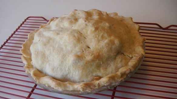 baked cortland apple pie with canola oil crust cooling on rack