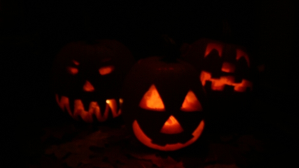 3 lighted hallowe'en pumpkins