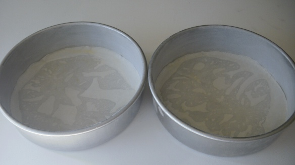 canola oil greased and floured cake pans with parchment paper