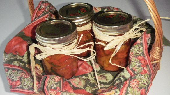 red and yellow roasted peppers in mason jars as a gift