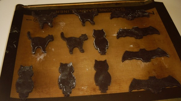 dairy, egg and peanut/tree nut free chocolate cookie dough cut outs on silicone lined baking sheet