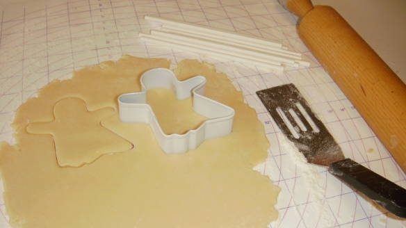 cutting out ghost cookies in dairy, egg, and peanut/tree nut free cookie dough