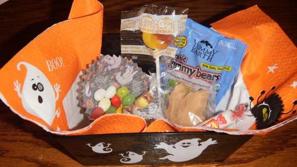 hallowe'en candies, gimbals jelly beans,yummy earth lollipops, candy drops and gummy bears, rockets and maple sugar candy in a take home container from hallowe'en party