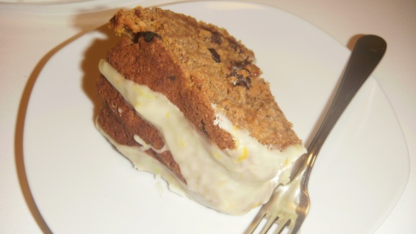 a slice of dairy, egg, soy and peanut/tree nut free pumpkin bundt cake with orange drizzle
