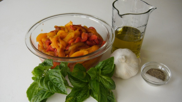 sliced red and yellow roasted peppers with extra-virgin olive oil, garlic, salt, pepper and fresh basil ingredients