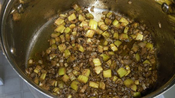 sauteeing celery, onion, herbs in canola oil for stuffing