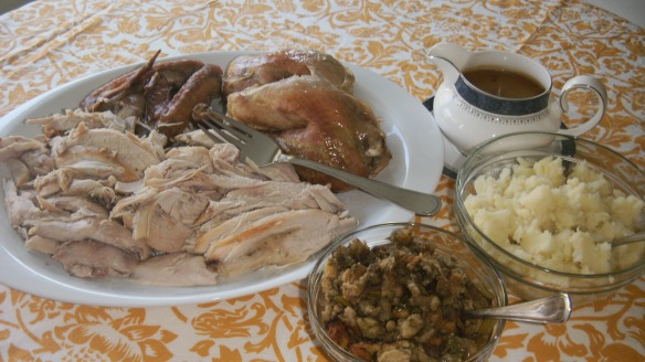 sliced roast turkey, dairy free stuffing, garlic mashed potatoes and gravy