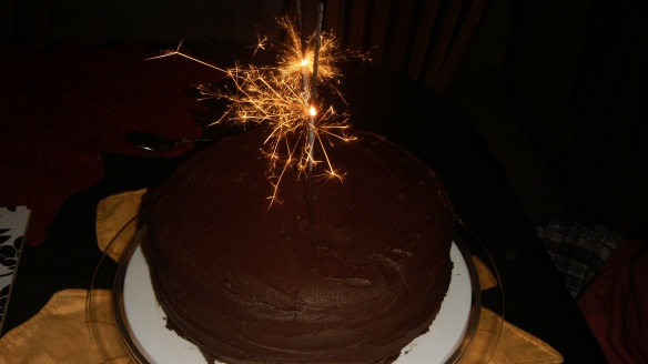 dairy and egg free chocolate birthday cake with sparkler on top