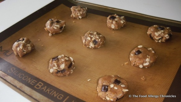 batter of dairy,egg,peanut/tree nut free oatmeal chocolate chunk cookies on cookie sheet