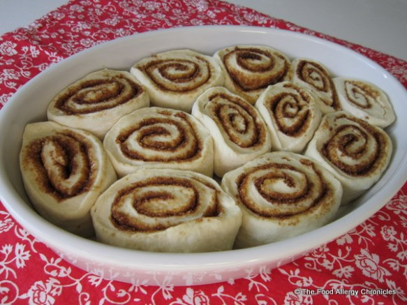 dairy,egg,soy and peanut/tree nut free cinnamon bun dough rolls in casserole dish