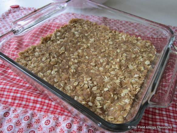 oatmeal mixture for dairy, egg, soy and peanut/tree nut free date squares pressed into baking pan