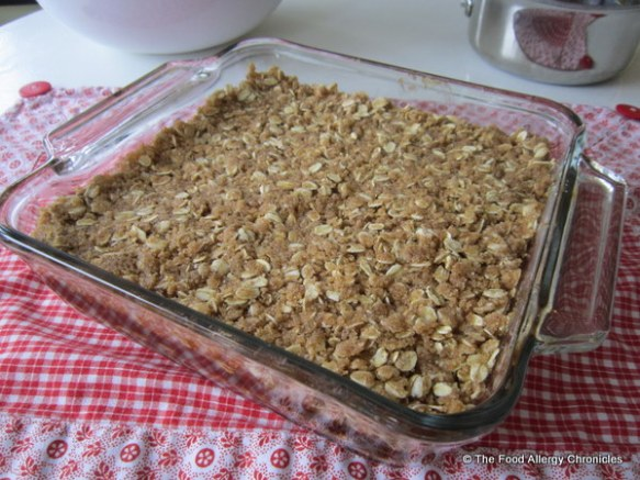 remaining oatmeal mixture patted on the date filling for dairy, egg, soy and peanut/tree nut free date squares