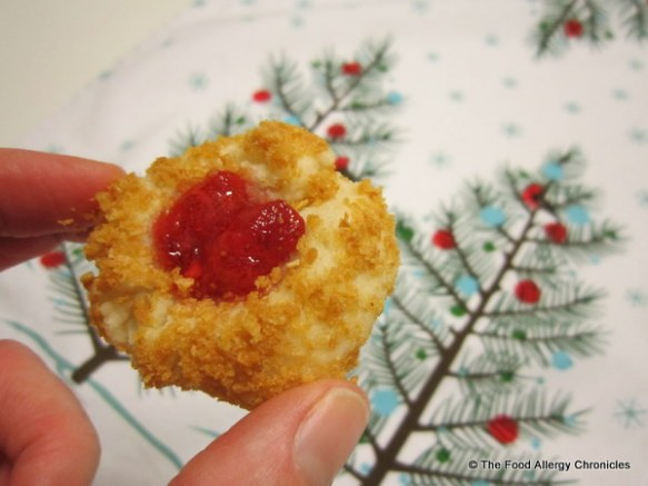 dairy, egg and peanut/tree nut free thumbprint cookie filled with strawberry jam