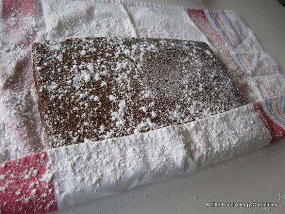 dairy, egg and peanut/tree nut free chocolate cake on icing sugar lined tea towel