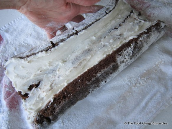 dairy,egg and peanut/tree nut free chocolate cake iced with vanilla icing