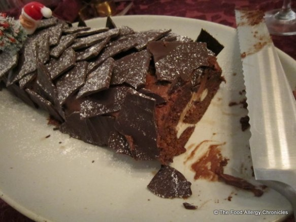 slicing the dairy, egg and peanut/tree nut free chocolate yule log with bread knife