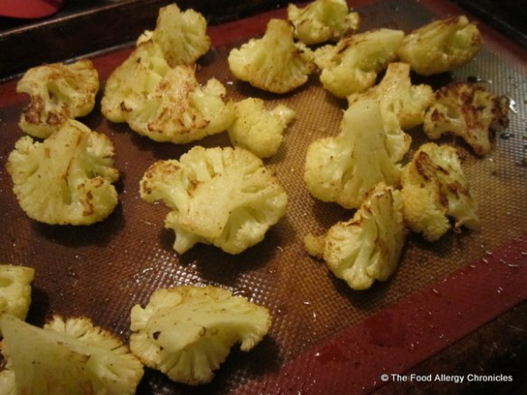 Roasted cauliflower on a silicone lined cookie sheet