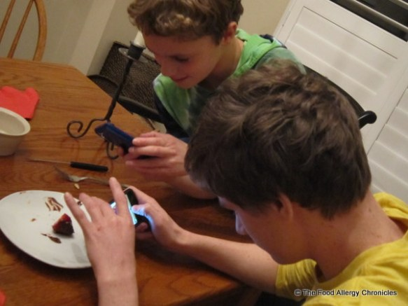 boys taking photos of the chocolate covered strawberry