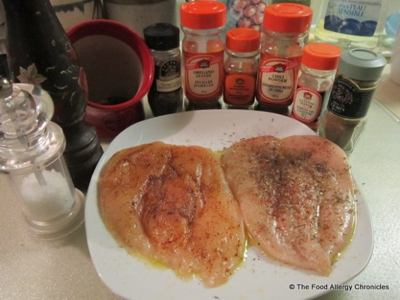 boys flattened chicken breasts with spices