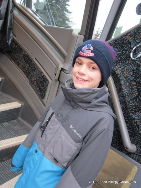 matthew boarding the bus to camp muskoka