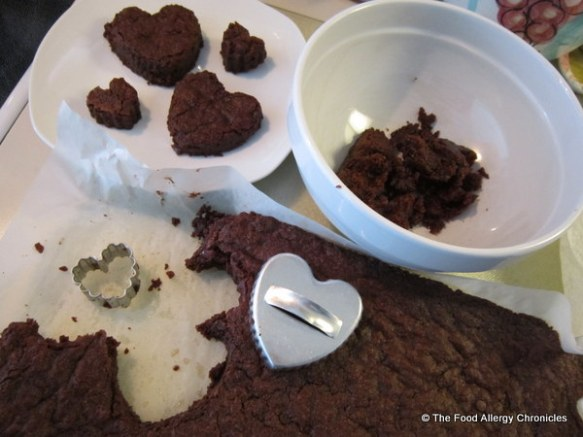 cutting out heart shaped brownies