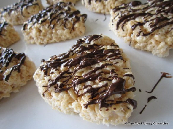 dairy free rice krispie hearts drizzled in melted enjoy life chocolate chips