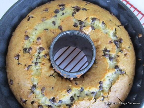 cake cooling in bundt pan on cooling rack