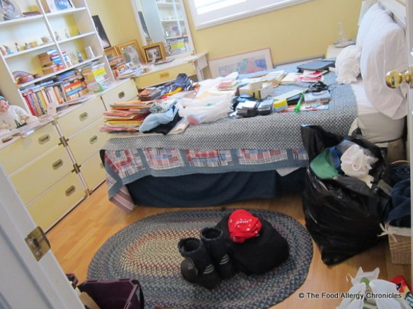 Cluttered guest bedroom