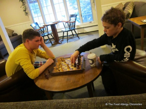 boys playing a game of chess in the lobby in Stowe, Vermont