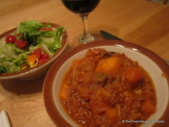 Pork Bourguignon with Salad and a glass of red wine