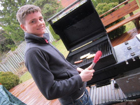 Michael bbqing his Schneider's all natural hot dog and toasting his Freihofer's hot dog bun