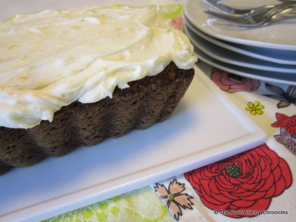 Dairy, Egg, Soy and Peanut/Tree Nut Free Carrot Cake with Orange Icing in a loaf pan