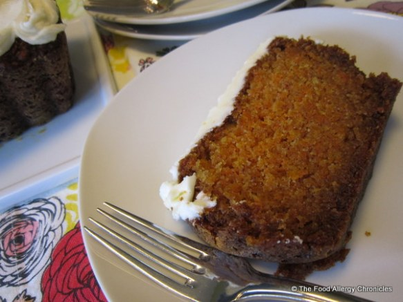 Enjoying a piece of Dairy, Egg, Soy and Peanut/Tree Nut Free Carrot Cake Loaf with Dairy Free Orange Icing