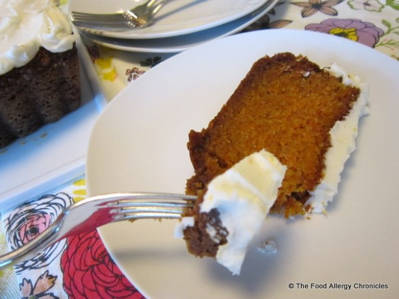 Enjoying a slice of Dairy, Egg, Soy and Peanut/Tree Nut Free Carrot Cake Loaf with Dairy Free Orange Icing