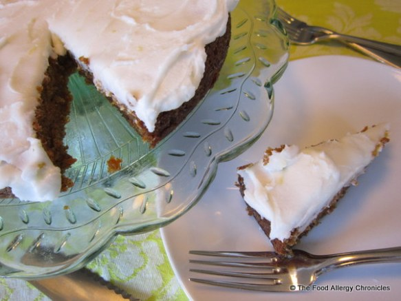 Dairy, Egg, Soy and Peanut/Tree Nut Free Carrot Cake with Lemon Icing baked in a round cake pan